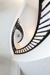 Looking Up at Architectural Details of an Ornate Spiral Staircase by James White