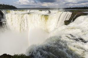 The headwater of Iguazu Falls with a rainbow from the Argentinian by James White