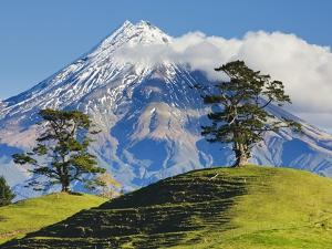 Lush hills in front of Mount Egmont by Jami Tarris