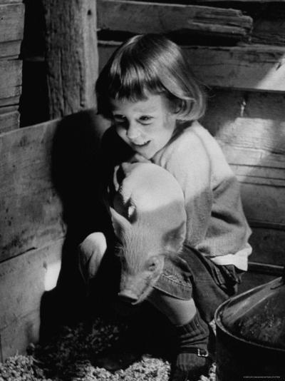 Jan Bruene with Piglet of a Group 2-3 Weeks Old, Kept in Basement of Home-Gordon Parks-Photographic Print