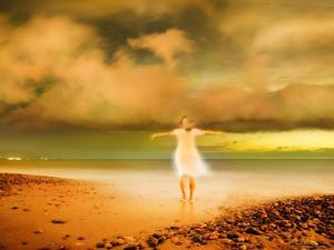 Glowing Woman Standing on the Beach by Jan Lakey