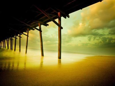 Pier over Calm Waters and Golden Sand
