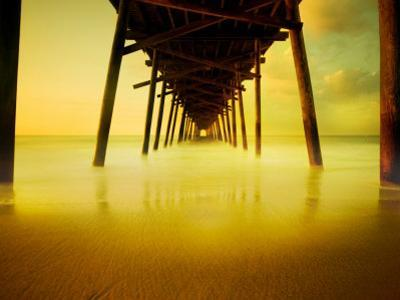 Pier over Golden Sand and Water
