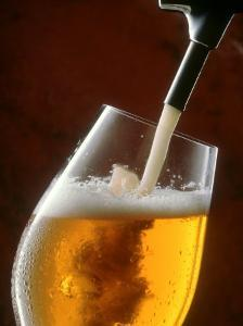 Pouring a Glass of Beer from the Tap by Jan-peter Westermann