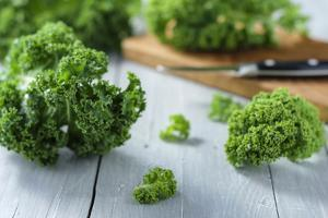 Fresh Kale on Gray Wooden Table by Jana Ihle