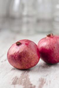 Two Pomegranates, Close-Up by Jana Ihle