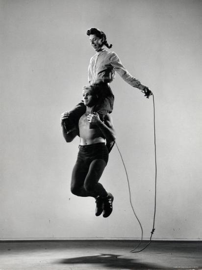 Jane Eakin on Shoulders of Rope Skipping Champion Gordon Hathaway-Gjon Mili-Photographic Print