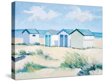 Beach Huts On A Bright Day