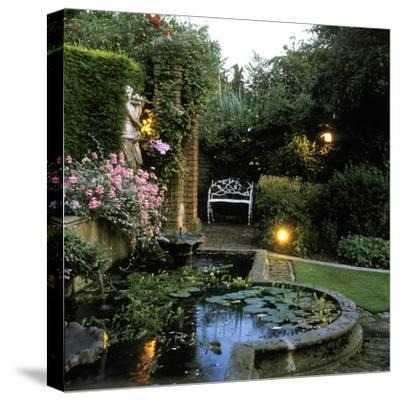 Garden Lighting Beside Italianate Pool & White Female Statue, Wrought Iron Bench