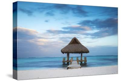 Dominican Republic, Punta Cana, Playa Blanca, Wooden Pier with Thatched Hut
