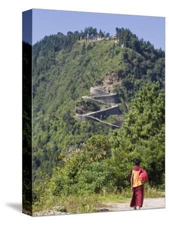 Novice Monk Walking Along Road to Sangachoeling Gompa, Pelling, Sikkim, India