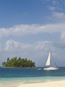 Panama, Comarca de Kuna Yala, San Blas Islands, Beach and Sailing Boat by Jane Sweeney