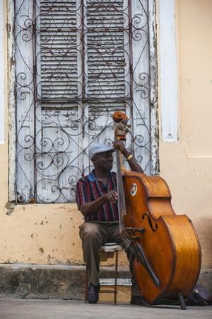 Santiago De Cuba Province, Historical Center, Street Musician Playing Double Bass by Jane Sweeney