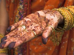 Wedding Guest Showing Henna Marking on Her Hand, Dubai, United Arab Emirates by Jane Sweeney
