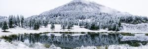 Yellowstone National Park, Wyoming, USA. Floating Island Lake surrounded by fresh Autumn snowfall. by Janet Horton