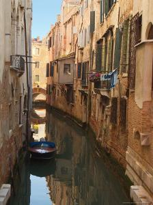 Boat Docked on a Side canal, Venice, Italy by Janis Miglavs