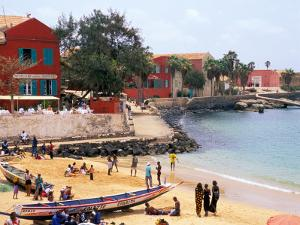 Boats and Beachgoers on the Beaches of Dakar, Senegal by Janis Miglavs