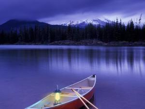 Canoe and Lantern on Banks of Sparks Lake, Cascade Range, Oregon, USA by Janis Miglavs