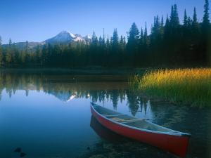 Canoe in Sparks Lake, Broken Top Mountain in Background, Cascade Mountains, Oregon, USA by Janis Miglavs