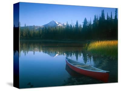 Canoe in Sparks Lake, Broken Top Mountain in Background, Cascade Mountains, Oregon, USA
