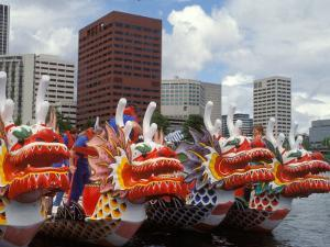 Contestants Preparing Dragon Boats for the Rose Festival Dragon Boat Races, Portland, Oregon, USA by Janis Miglavs