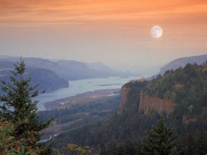Moon Hangs Over the Vista House, Crown Point, Columbia river Gorge, Oregon, USA by Janis Miglavs