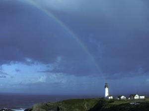 Rainbow over Yaquina Bay Lighthouse, Oregon, USA by Janis Miglavs