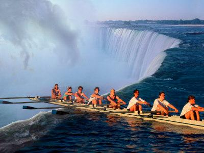Rowers Hang Over the Edge at Niagra Falls, US-Canada Border