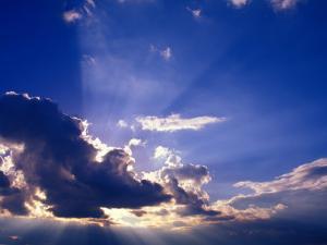 Sunrays Burst Through the Clouds by Janis Miglavs