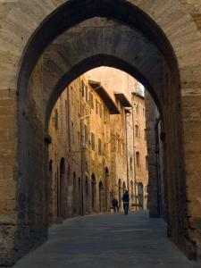 Walking Down the Medieval Streets, San Gimignano, Tuscany, Italy by Janis Miglavs