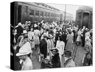 Japanese-American Internees Waiting to Board Train to Santa Anita, Los Angeles, c.1942