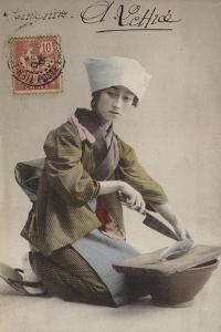 Japanese Girl Filleting Fish
