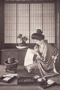 Japanese Woman Writing, 1933 by Japanese Photographer