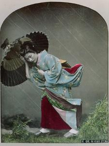 Young Japanese Girl in the Rain, c.1900 by Japanese Photographer