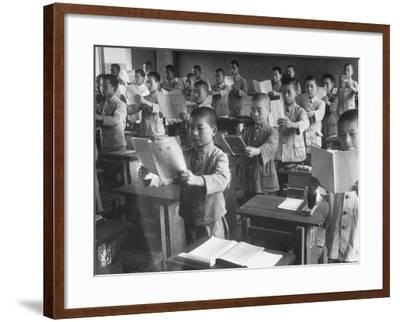 Japanese School Students Learning New Way of Reading--Framed Photographic Print