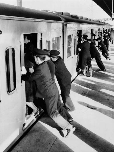 Japanese Students Employed as Uniformed 'Pushers' Cramming Commuter Cars, 1962--Photo