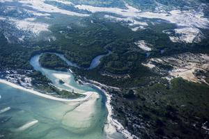 A Coastal Tidal River Flows from the Ocean into Salt Marsh and Mangrove Forests by Jason Edwards