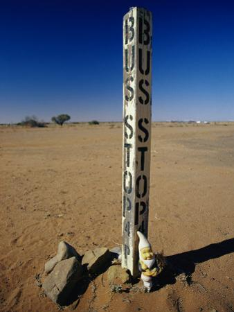 A Garden Gnome at a Bus Stop in an Outback Desert Town by Jason Edwards
