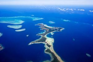 A Sand Spit Island Surrounded by Coral Reefs and a Vast Blue Ocean by Jason Edwards