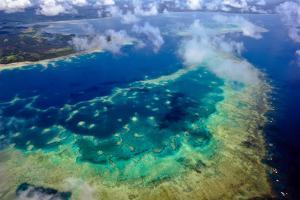 A Vast Pristine Coral Reef Surrounding a Tropical Island by Jason Edwards