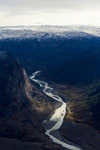 A Winding River Snakes its Way Through a Highland Tundra Valley Between Steep Mountains by Jason Edwards