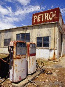An Antique Rusting and Abandoned Gas Station in a Rural Country Town by Jason Edwards