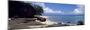 An Idyllic Cove Overlooks a Turquoise Lagoon on a Tropical Island by Jason Edwards