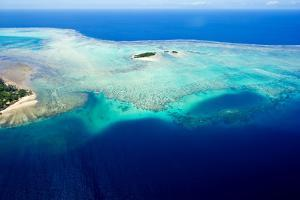 Coral Reefs Stretch Out from the Shoreline of a Tropical Island by Jason Edwards