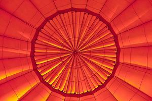 Dawn Illuminates the Vents of an Inflated Hot Air Balloon by Jason Edwards