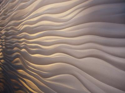 Lighting Illiuminates an Architectural Display of Waves in a Wall by Jason Edwards