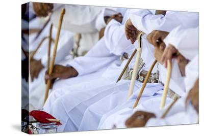 Muslim Elders Holding Ceremonial Canes While They Watch Camel Racing in the Desert