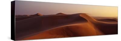 Sunset Shines on Sand Dunes in the Desert