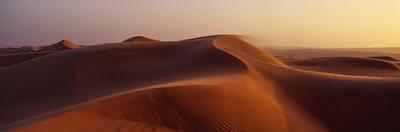 Sunset Shines on Sand Dunes in the Desert by Jason Edwards