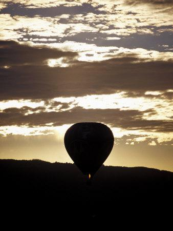 The Silhouette of a Hot Air Balloon and Jet Flame at Dawn, Australia